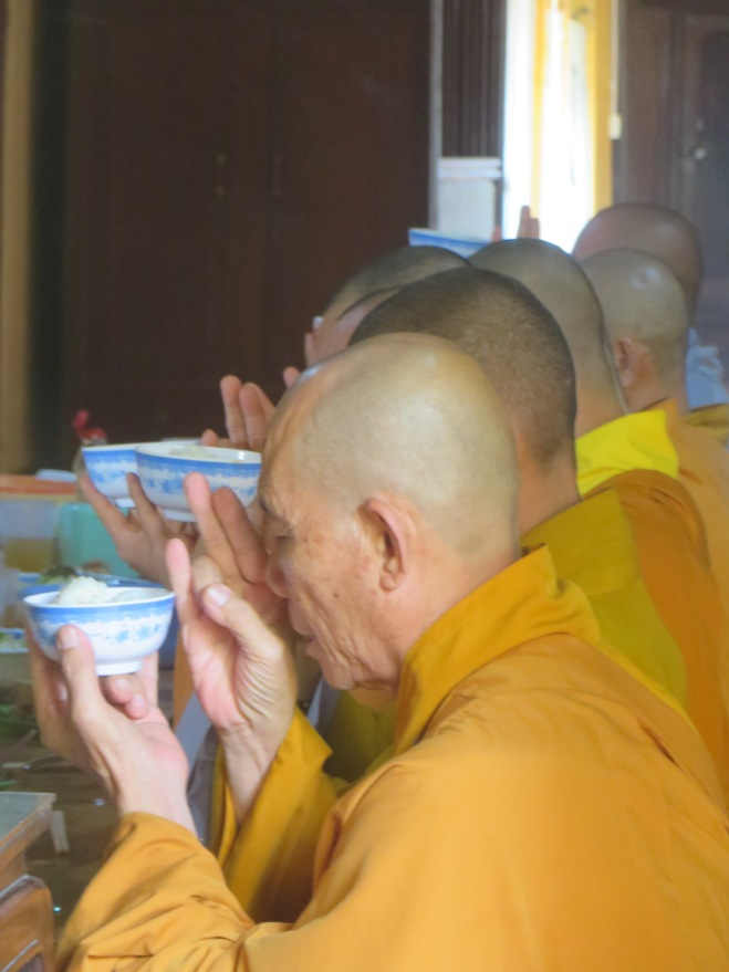 Monks praying before lunch