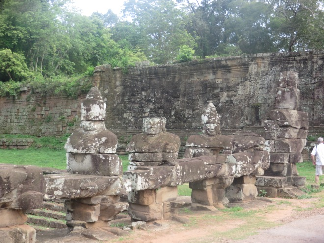 Beautiful ruins near the entrance (men holding a cobra which protects Buddha)