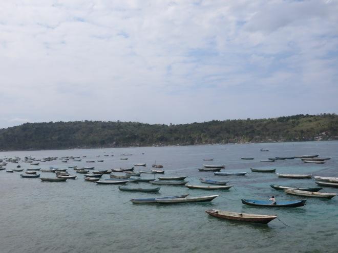 Boats resting off shore