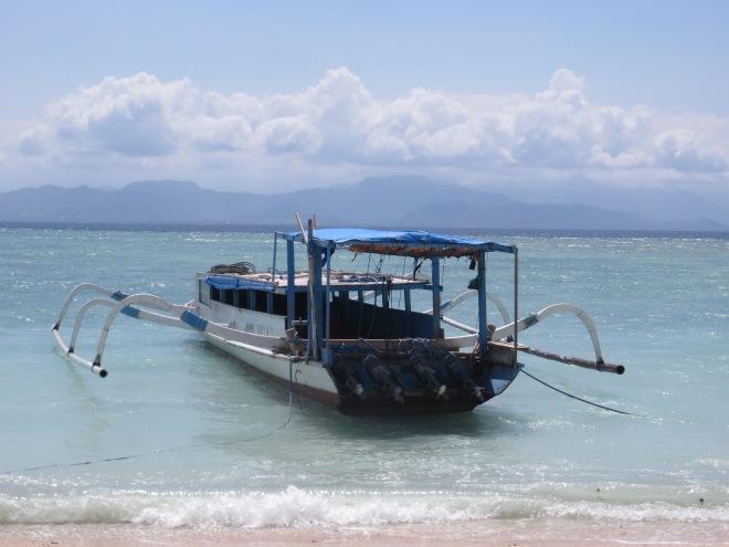 Boats docked off shore