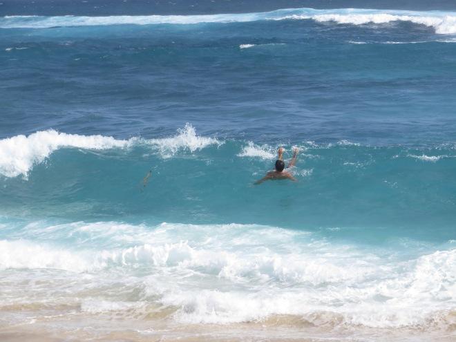 "Rob riding the ""rough"" waves on Dream Beach"