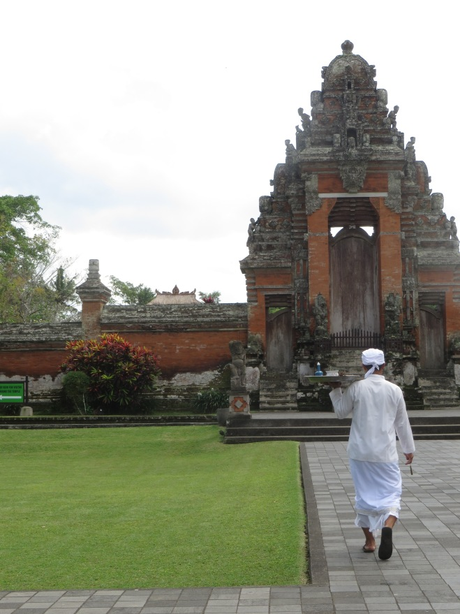Official walking to the temple to give alms