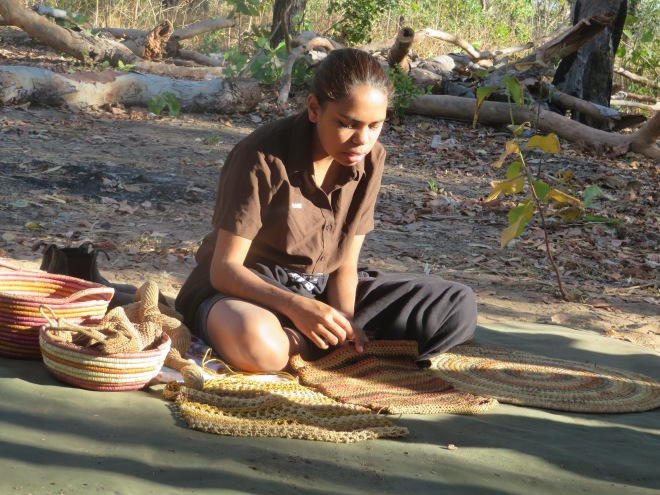 Young aboriginal girl teaching us about her culture.
